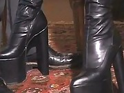 Tranny in boots sucking