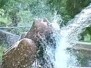 TS bathing in waterfall